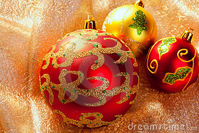 Christmas red baubles on golden fabric