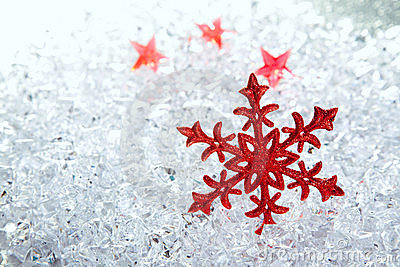 Christmas red snowflake on winter ice