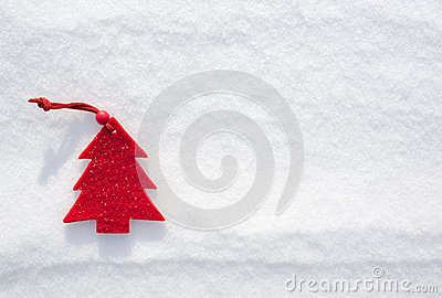 Christmas red tree toys at snow