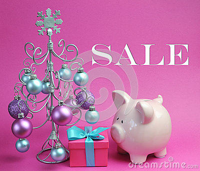 Christmas Sale still life with pastel pink and blue, with silver Christmas Tree and baubles