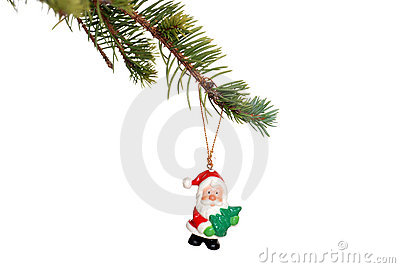 Christmas santa decoration on a spruce tree branch