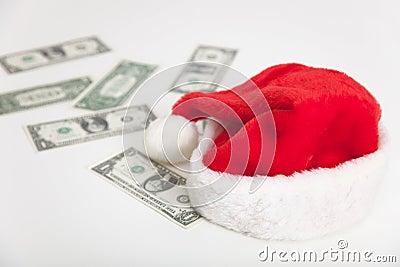 Christmas santa hat and dollars