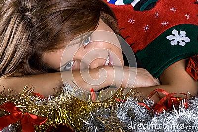 Christmas season. Brunette female model.
