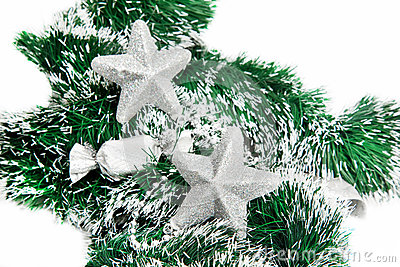 Christmas shiny stars on green tinsel