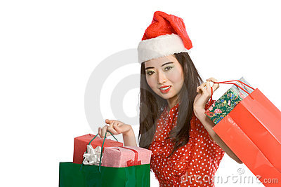 Christmas shopping of Asian woman with gift bags