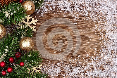 Christmas side border with gold ornaments, branches and snow frame Stock Photo