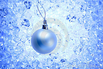 Christmas silver bauble on blue winter ice