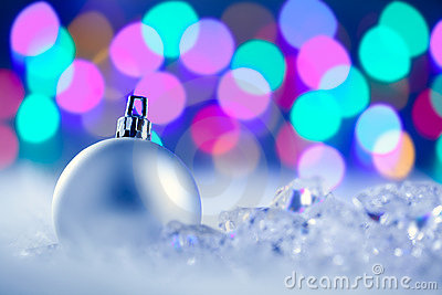 Christmas silver bauble in blurred lights