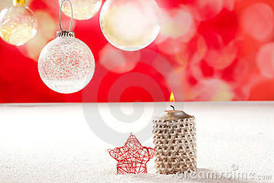 Christmas silver candle and red star on snow