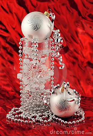 Christmas silver decoration on red background