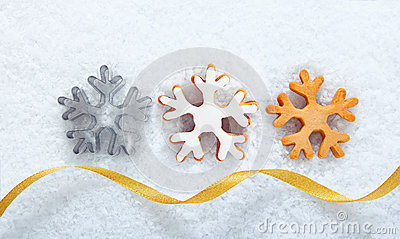 Christmas snowflake cookies on snow