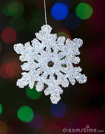 Christmas snowflake ornament with defocused lights