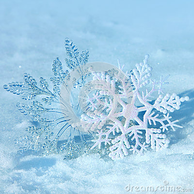 Christmas snowflakes on snow
