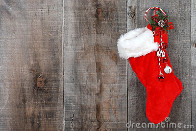 Christmas sock and wreath on wood