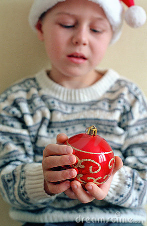 Christmas sphere in child hands