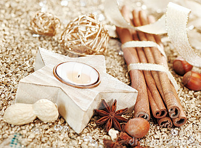 Christmas star candle and spices