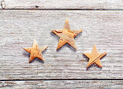 Christmas stars on grungy wood