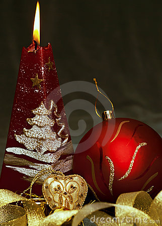 Christmas  still life - red burning candle with ev