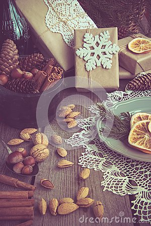 Free Christmas Still Life With Giftbox, Bowl With Walnuts, Almond, Cinnamon, Snowflakes On Wooden Table. Top View. Royalty Free Stock Photos - 99869408