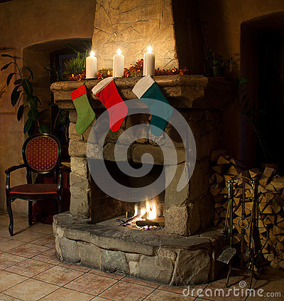 Free Christmas Stocking On Vintage Stone Tiles Fireplace Stock Image - 60592841