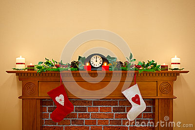 Christmas stockings and garland on a mantlepiece