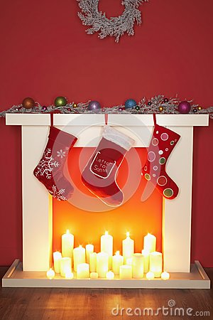 Christmas stockings hanging over fireplace royalty free for Stocking clips for fireplace