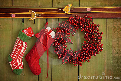 Christmas stockings and wreath hanging on  wall