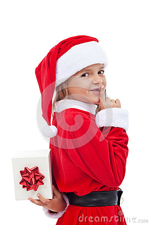 Free Christmas Surprise With Little Girl Dressed As Santa Stock Image - 34521701
