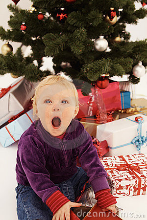 Christmas - Surprised child opening gifts