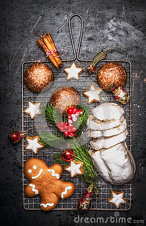 Free Christmas Sweet Baking Food : Homemade Gingerbread, Cookies, Stollen With Spices , Fir Branches And Red Holiday Decoration On Dark Royalty Free Stock Images - 81371989