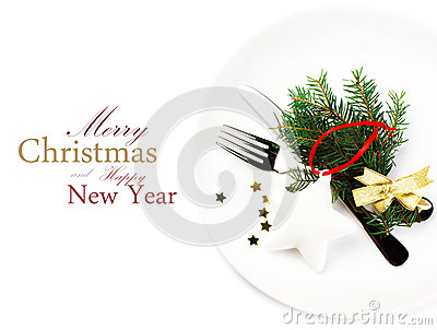 Christmas table setting with festive decorations on white plate