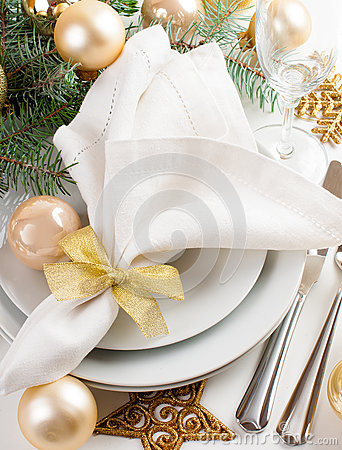 Christmas table setting in gold tones
