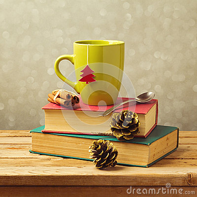 Free Christmas Tea Mug On Books With Decorations Stock Photos - 46414053