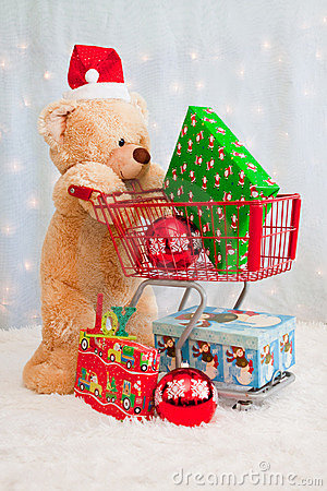 Christmas teddy bear pushing shopping cart