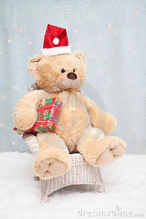 Christmas teddy bear sitting on chair
