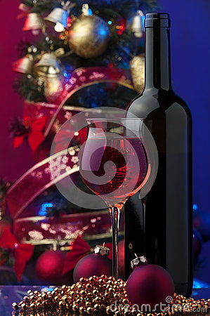 Christmas time bottle and glass of rose wine