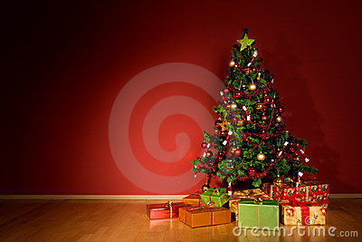 Christmas tree with christmas gifts in red room