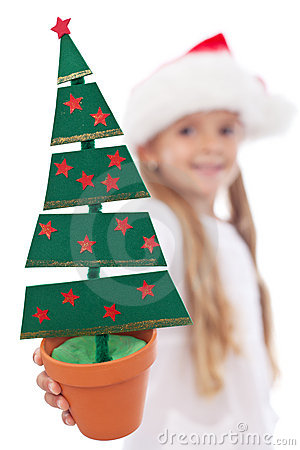 Christmas tree decoration in litte girl hand