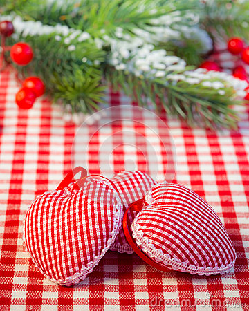 Christmas tree decorations and branch on red gingham tablecloth