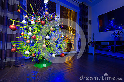 Christmas tree with decorations at home