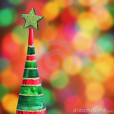 Christmas tree on defocused lights background