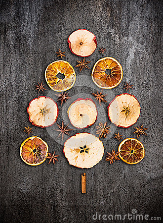 Free Christmas Tree Made Dry Apples, Oranges And Anise On Gray Texture Royalty Free Stock Photography - 47159167