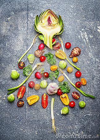 Free Christmas Tree Made of Fresh Vegetables On Gray Rustic Bac Stock Images - 62733874