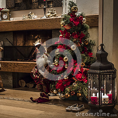 Christmas tree near fireplace with decorations stock photo for Home decorations next