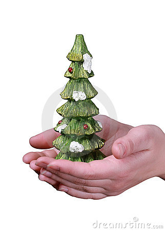 Christmas tree souvenir in hands