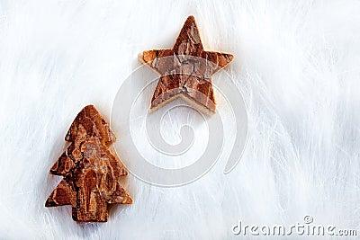 Christmas tree and star over white fur