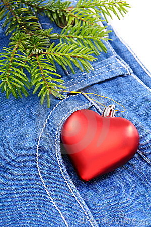 Christmas tree and toy on denim background.