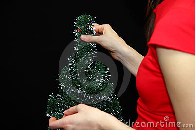 Christmas tree in woman hands