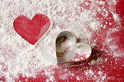 Christmas : Two hearts on red and white background