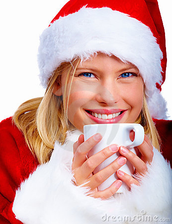 Christmas woman drinking a cup of hot chocolate